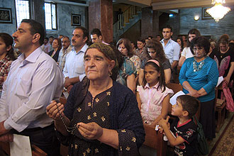 <p>Around 1,500 people - including Arabs, Kurds and Turkmen - gathered at the Chaldean Cathedral late on Tuesday, singing Christian hymns before reciting prayers and verses from the Bible and the Koran. -- PHOTO: AFP</p>