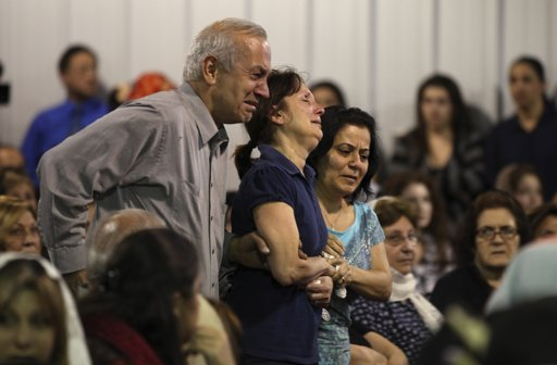 Tony and Virginia Badal, parents of Ramina Badal, are escorted into a vigil service at the Holy Apostolic Catholic Assyrian Church of the East, St George Parish, Wednesday, July 20, 2011, in Ceres, Calif. Ramina Badal, 21, is among the three people presumed dead after being swept over a raging waterfall in Yosemite National Park on Tuesday. The three were believed to be in Yosemite as part of a Modesto, Calif., based youth church outing. (AP Photo/Ben Margot)
