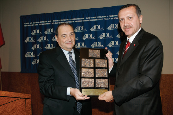 Turkey's Prime Minister Recep Tayyip Erdogan receives the Anti-Defamation League's 'Courage to Care' award from ADL National Director Abraham Foxman at the ADL headquarters in New York on June 10, 2005 (Credit: David Karp and St. Louis Jewish Light). The League's Courage To Care Award was established to pay tribute to those men and women of courage and honor who, in the midst of the Holocaust, risked their own lives to save Jews.
