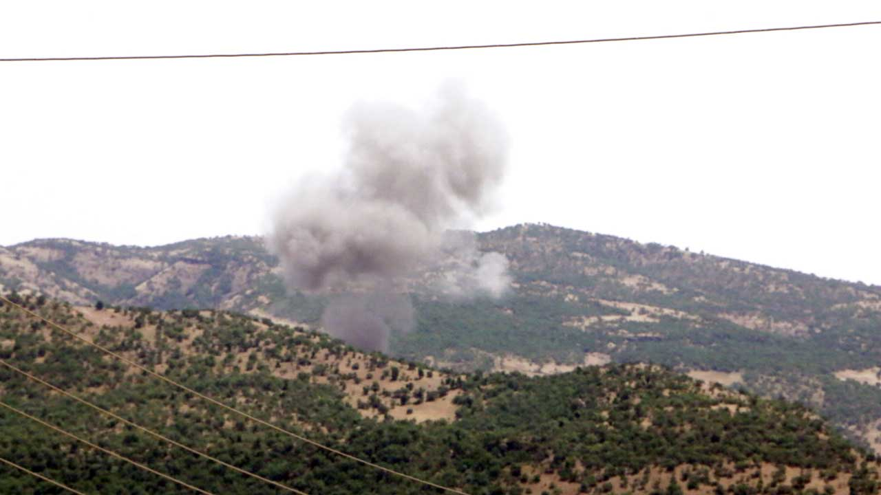 A Turkish shell hits not far from where we interviewed residents. Immediately afterwards, PKK insurgents calmly strolled down our street as if to send the message the shelling was ineffective.