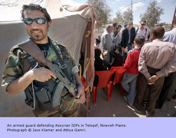 An armed guard defending Assyrian IDPs in Telsqof, Nineveh Plains.