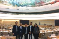 Participants prepare to leave on the last day of the Human Rights Council session.