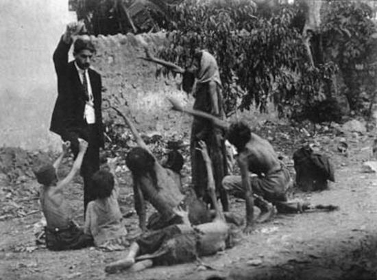 Turkish official teasing starving Armenian children by showing bread, 1915.  Collection of St. Lazar Mkhitarian Congregation.