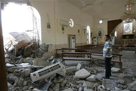 A man stands among debris inside a church after a bomb attack in central Kirkuk, 250 km (155 miles) north of Baghdad August 2, 2011. Photo: Reuters / Ako Rasheed