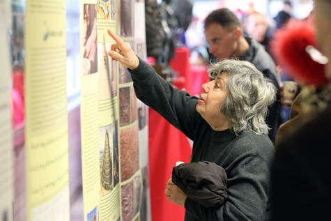 Marie Simon reads about Assyrian history Sunday during the Coming Together In Skokie kickoff event at Niles West High School. | Jerry Daliege~for Sun-Times Media