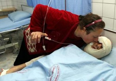 A woman kisses her wounded son, the victim of a bomb attack, at a hospital in Arbil, 310 km (190 miles) north of Baghdad, May 2, 2010. Two bombs killed one person and injured 100 others in northern Iraq on Sunday, police said, in what appeared to be an attack on the country's Christian minority. Photo: Azad Lashkari / REUTERS