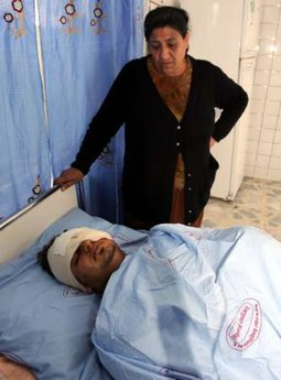 A woman looks at her wounded son, who was injured in a bomb attack in northern Iraq, after he was transferred to a hospital in Arbil, 310 km (190 miles)north of Baghdad May 2, 2010. Two bombs killed one person and injured 100 others in northern Iraq on Sunday, police said, in what appeared to be an attack on the country's Christian minority.