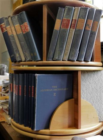 Volumes of the University of Chicago's Assyrian Dictionary on bookshelves